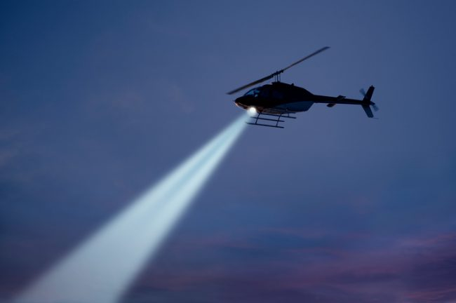 Police helicopter with strong searchlight.