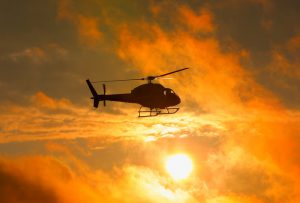 Silhouette of military helicopter at sunset